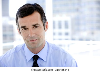 Portrait of a male business manager at workplace