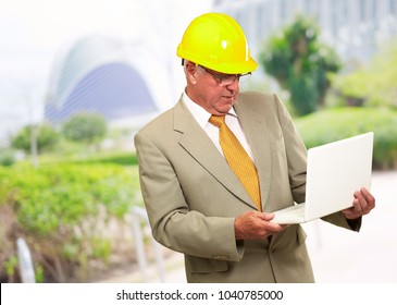 Portrait Of A Male Contractor Using Laptop, Outdoor