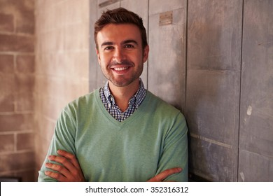 Portrait Of Male Designer Standing In Modern Office