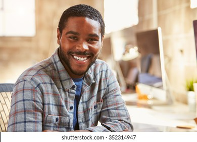 Portrait Of Male Designer Working At Desk In Modern Office