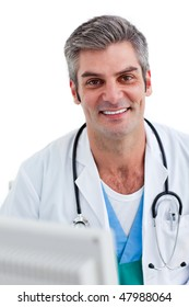 Portrait of a male doctor holding a stethoscope against a white background