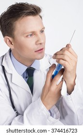 Portrait of male doctor with stethoscope engaged in his work.