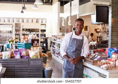 Portrait Of Male Employee Working In Delicatessen