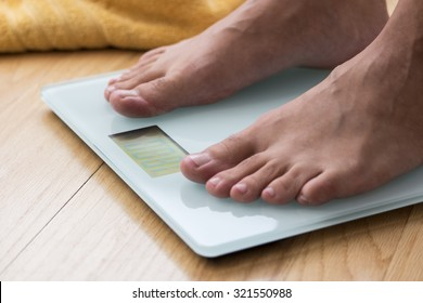 Portrait of male feet on a scale