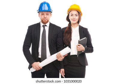 Portrait of male and female engineers wearing hardhats