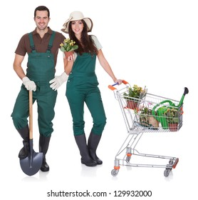 Portrait of male and female gardeners. Isolated on white