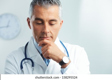Portrait of a male handsome doctor thinking