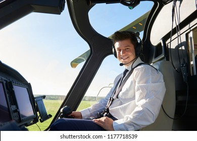 Portrait Of Male Helicopter Pilot In Cockpit Before Flight