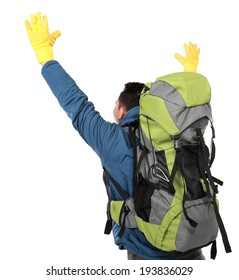 portrait of male hiker with backpack raised his arm. shoot from behind isolated on white background