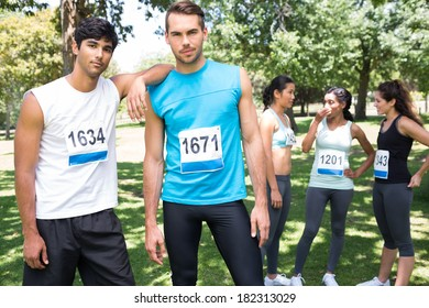 Portrait of male marathon runners at a race in the park
