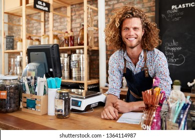 Portrait Of Male Owner Of Sustainable Plastic Free Grocery Store Behind Sales Desk