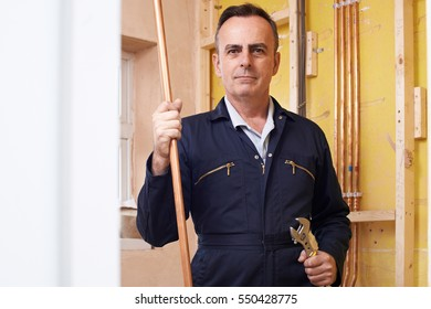 Portrait Of Male Plumber Working In House