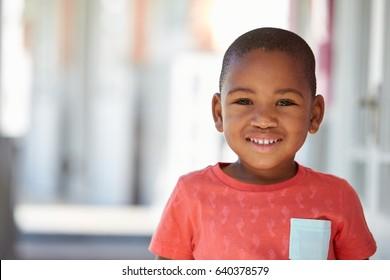 Portrait Of Male Pupil Outside Classroom At Montessori School