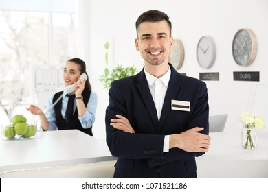 Portrait of male receptionist at workplace in hotel