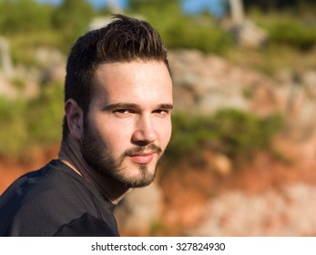 Portrait Of Male Runner in nature after jogging