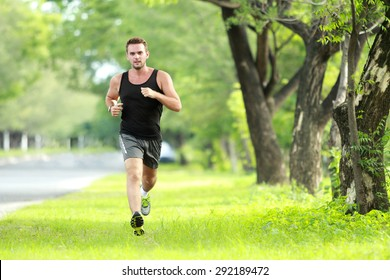 portrait of male runner training for marathon with copy space