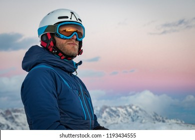 Portrait of a male skier on the mountain at sunset