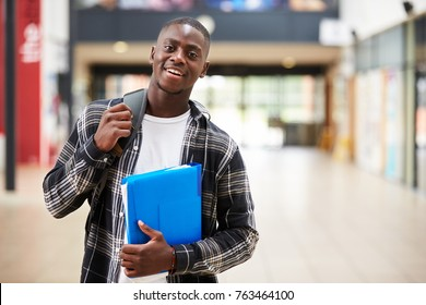 Portrait Of Male Student Standing In College Building