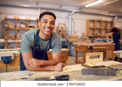 Portrait Of Male Student Studying For Carpentry Apprenticeship At College