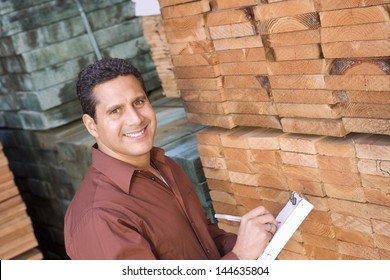Portrait of a male supervisor stock taking in warehouse