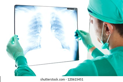 Portrait of a male surgeon examining a radiography