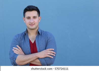 Portrait of man with arms crossed - Stock image