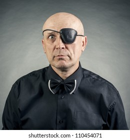 portrait of a man with a bandage on the eye