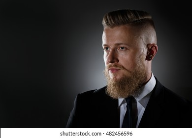 Portrait of a man with a beard in a business suit