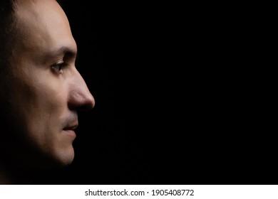 portrait of a man black background