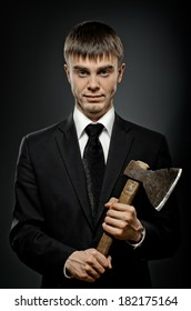 portrait  man in black costume and black necktie with axe, sinister look
