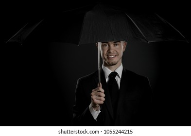portrait man in black costume with umbrella,  special-service agent