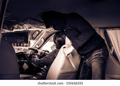 Portrait man in black mask,Man hands holding knife hijack and kill woman in the car,Dangerous man,Crime concept