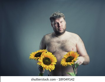 Portrait of man with bouquet  sunflowers