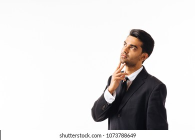 Portrait of a man in business suit, hand on chin and  looking up,isolated on white background