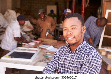 Portrait of man in a busy carpentry workshop, South Africa