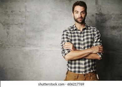 Portrait of man in checked shirt, studio