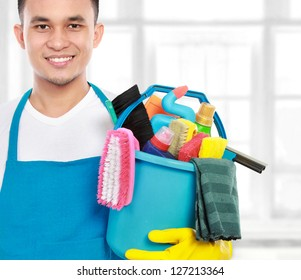 portrait of man with cleaning equipment ready to work