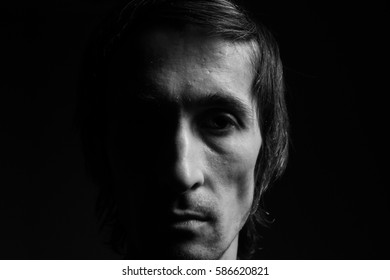 portrait of a man close up. black and white photography