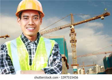Portrait of man construction worker standing front of wall construction