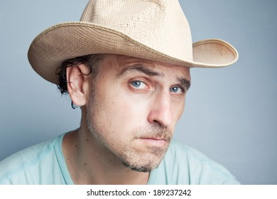 Portrait of a man in a cowboy hat