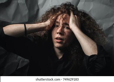 Portrait of a man in despair. low key