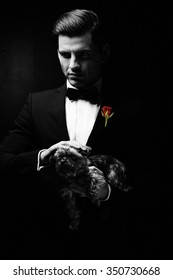 Portrait of man with dog, godfather-like character.