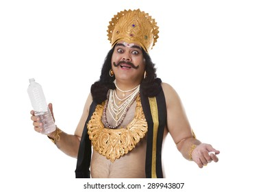 Portrait of a man dressed as Raavan with a bottle of water
