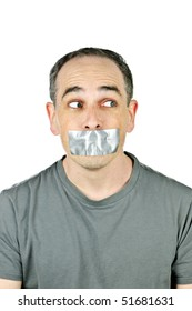 Portrait of man with duct tape over his mouth glancing sideways