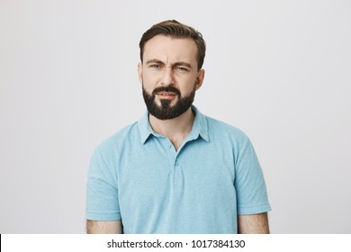 Portrait of a man with facial hair looking confused and questioned. Emotions concept. Guy started attend chinese classes and can not understand a single word his teacher saying to him.