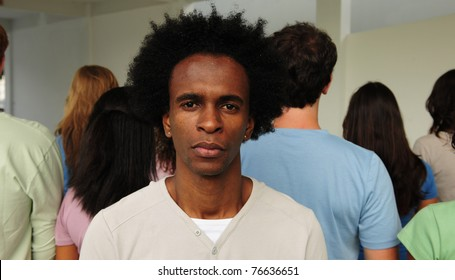 Portrait of a man facing opposite direction to crowd