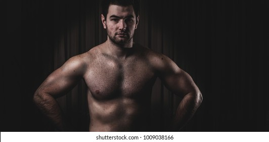 portrait of a man, fitness model, black background