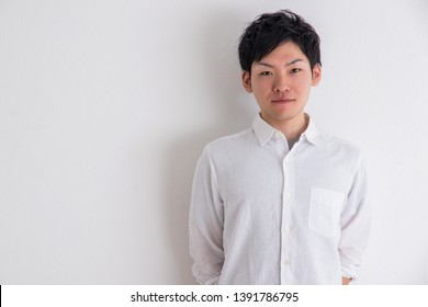 Portrait of a man in front of a white wall