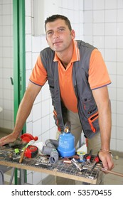 Portrait of a man in front of a work plan