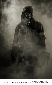 Portrait of a man in a gas mask in smoke after the crash
